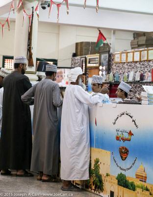 Omani men buying Halwa
