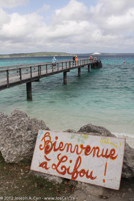 Welcome sign at the end of the wharf - 'Bienvenue à Lifou'