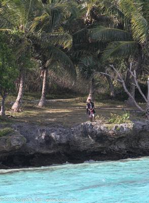 Man on shoreline, watching us depart