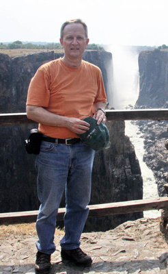 Joe standing beside the Victoria Falls gorge - a hot day!