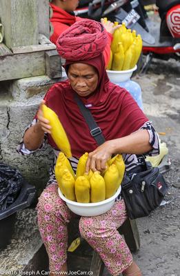 Woman selling corn