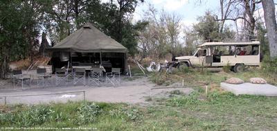 Meal & bar tent, open air fireside lounge and our Land Rover