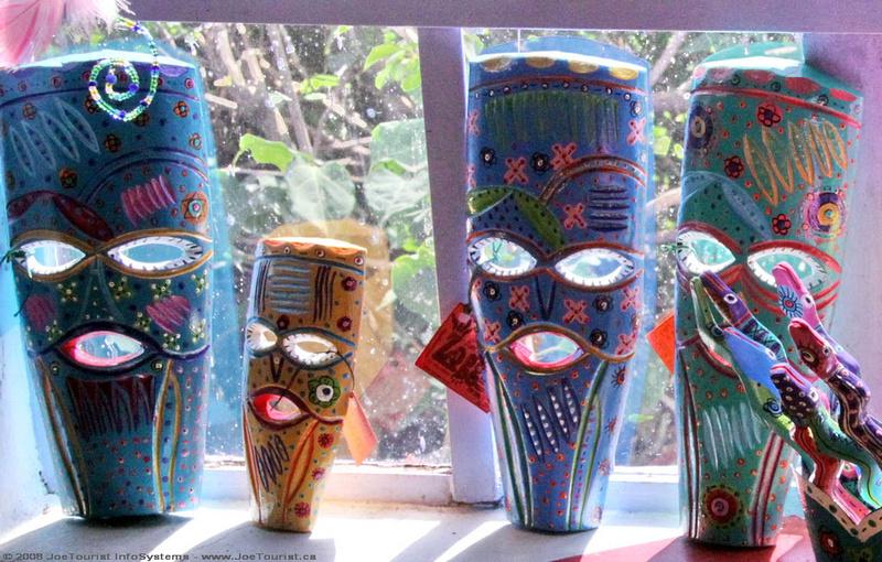 Folk art masks in the window