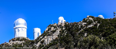 The Mayall, Stewart, UofA Spacewatch and Warner & Swasey observatories on the north ridgeline