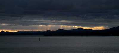 Crepuscular rays near sunset over the outer harbour