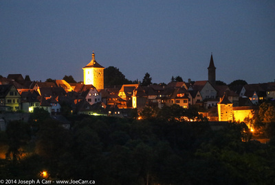 Looking back at night over the Tauber valley at the city from Castle Park
