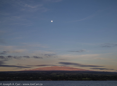 Sunrise over Maunakea with a Full Moon