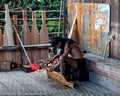 Man making a stringed musical instrument in the Orang Ulu longhouse