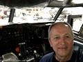 Joe inside a Boeing 720B cockpit simulator