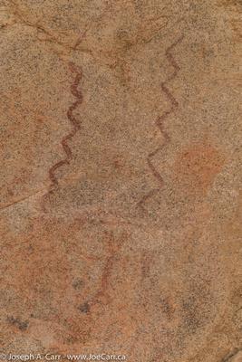 Petroglyphs on a boulder