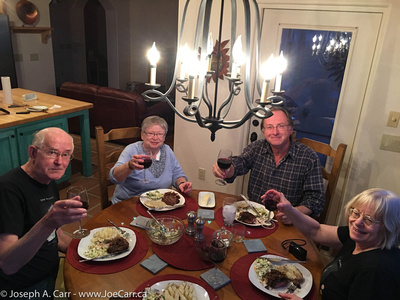 John, Lauri, Garry and Diane toasting our steak dinner