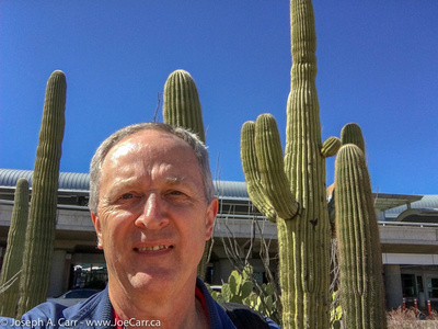 Joe's selfie in front of some Saguero cactus outside the airport entrance