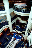 The piano at the top of the multi-level atrium and the restaurant at the bottom