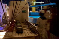 Crew rigging the ship for full sail