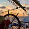 Sunset over the Caribbean framed by the stern wheel
