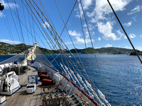 The foredeck of the Royal Clipper and Gustavia harbour