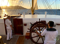The helmsman on the wheel as Captain Sergey Tunikov directs from the bridge