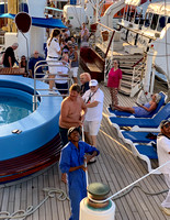 Passengers hoisting the sails with the Cruise Director urging them on