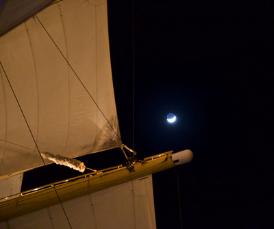 The Crescent Moon next to the sails