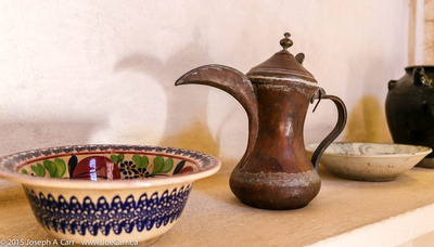A decorated bowl and a jug with a big spout