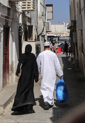 An Omani couple with their shopping from the souq