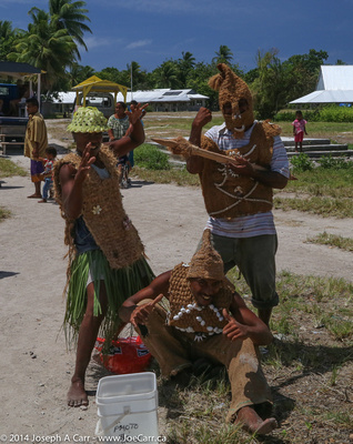 Islander men in traditional warrier armour made from coconut husk and shells