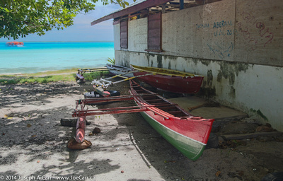 Outrigger canoes with the lagoon behind