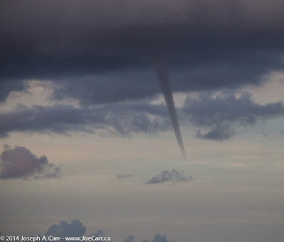 Funnel cloud forming from a thunder cloud