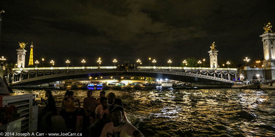 Pont de Concorde at night with the Eiffel Tower in the distance