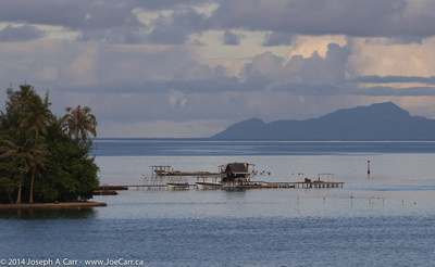 A fishing shack on Taha'a with Raiatea behind