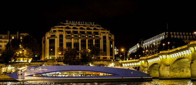 Le Paris dinner cruise boat on the Seine with La Samaritaine store lit at night