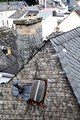 Slate tile roofs and chimneys on the old houses