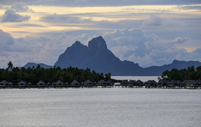 A resort on the west shore of Taha'a with Bora Bora looming behind