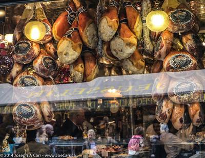 Hams hanging in a butcher's window
