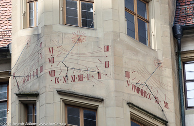 Sundials on three sides of a building