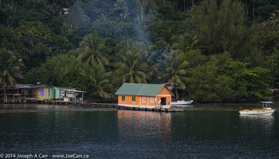 Bright orange boathouse and fishing shack