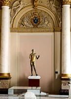 Metal sculpture of a boy standing