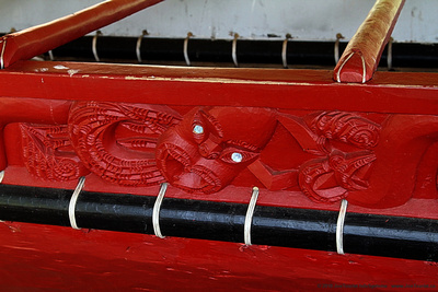 Carved figures on side of giant canoe Ngatokimatawhaorua
